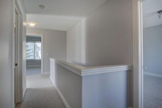 Photo 19: 76 Bridleridge Manor SW in Calgary: Bridlewood Row/Townhouse for sale : MLS®# A1106883