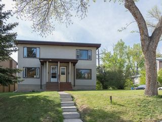 Photo 2: 921 36A Street NW in Calgary: Parkdale House for sale : MLS®# C4118357