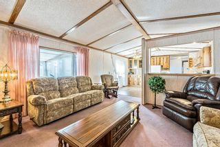 Photo 4: 301 Burroughs Circle NE in Calgary: Monterey Park Mobile for sale : MLS®# A1070742