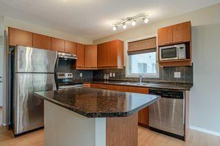 Photo 2: 41 287 MACEWAN Road in Edmonton: Zone 55 House Half Duplex for sale : MLS®# E4258475