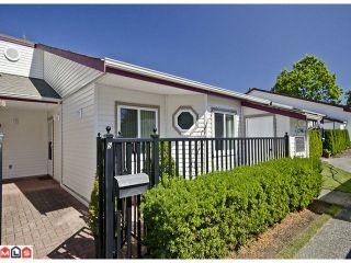 "Photo 1: 5 12943 16TH Avenue in Surrey: Crescent Bch Ocean Pk. Townhouse for sale in ""Ocean Park Village"" (South Surrey White Rock)  : MLS®# F1121397"