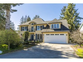 Photo 1: 3417 199A Street in Langley: Brookswood Langley House for sale : MLS®# R2566592