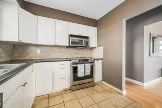 Photo 6: 7407 Fountain Road SE in Calgary: Fairview Detached for sale : MLS®# A1103326