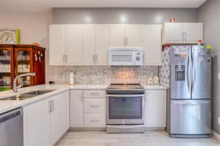 """Photo 13: 13 14555 68 Avenue in Surrey: East Newton Townhouse for sale in """"Sync"""" : MLS®# R2593338"""