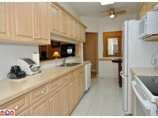 "Photo 4: 423 13880 70TH Avenue in Surrey: East Newton Condo for sale in ""CHELSEA GARDENS"" : MLS®# F1200411"