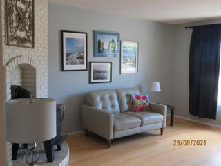 Photo 3: 357 Woodvale Crescent SW in Calgary: Woodlands Semi Detached for sale : MLS®# A1135631