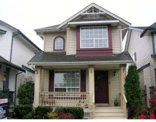 """Photo 1: 18540 64A Avenue in Surrey: Cloverdale BC House for sale in """"Clover Valley Station"""" (Cloverdale)  : MLS®# F2624892"""