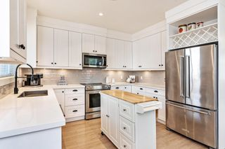 """Photo 2: 9 5945 177B Street in Surrey: Cloverdale BC Townhouse for sale in """"THE CLOVER"""" (Cloverdale)  : MLS®# R2624605"""