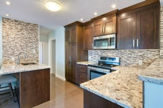 Photo 8: 1 Manor Road SW in Calgary: Meadowlark Park Detached for sale : MLS®# A1150982