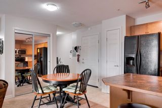 Photo 9: 1302 92 Crystal Shores Road: Okotoks Apartment for sale : MLS®# A1132113