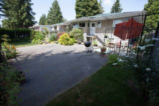 Photo 1: 22034 LOUGHEED Highway in Maple Ridge: West Central House for sale : MLS®# R2058894