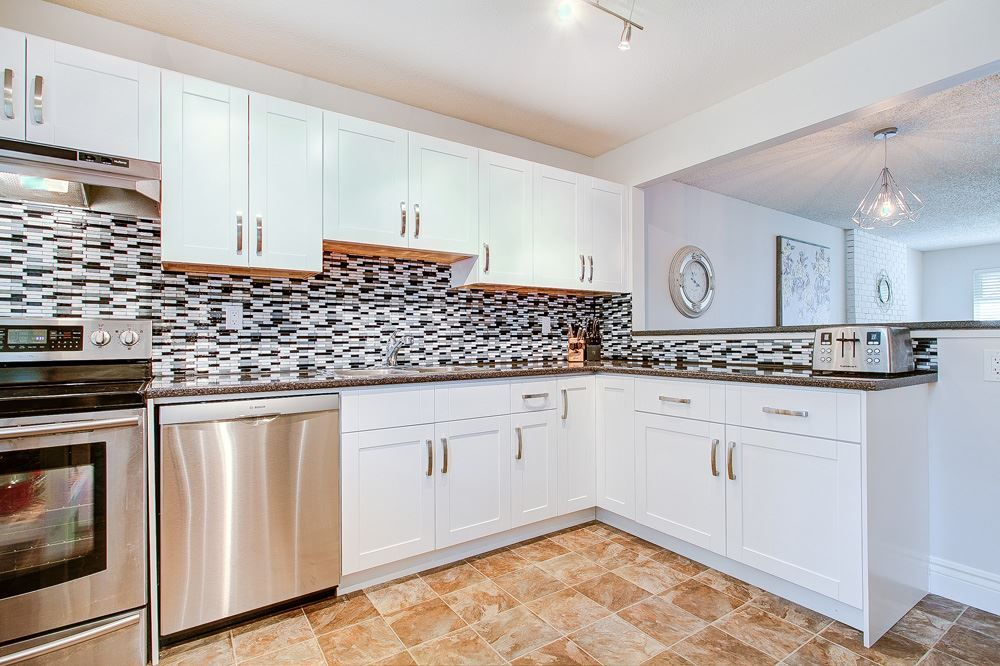 """Main Photo: 1245 BLUFF Drive in Coquitlam: River Springs House for sale in """"River Springs"""" : MLS®# R2357024"""