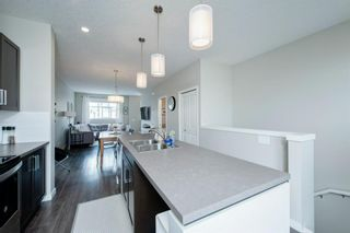 Photo 4: 62 Copperstone Common SE in Calgary: Copperfield Row/Townhouse for sale : MLS®# A1140452