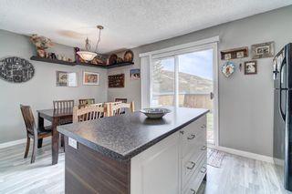 Photo 11: 32 800 Bowcroft Place: Cochrane Row/Townhouse for sale : MLS®# A1106385