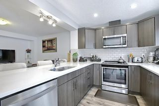 Photo 6: 110 Hillcrest Gardens SW: Airdrie Row/Townhouse for sale : MLS®# A1090717