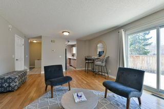Photo 11: 1301 829 Coach Bluff Crescent in Calgary: Coach Hill Row/Townhouse for sale : MLS®# A1094909