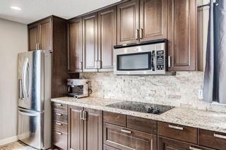 Photo 14: 335 Woodpark Place SW in Calgary: Woodlands Detached for sale : MLS®# A1110869