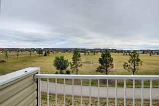 Photo 10: 63 Redstone Circle NE in Calgary: Redstone Row/Townhouse for sale : MLS®# A1141777