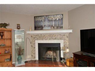 Photo 9: 10 GLENPATRICK Crescent: Cochrane House for sale : MLS®# C4094257