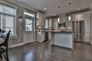 "Photo 13: 10 6929 142 Street in Surrey: East Newton Townhouse for sale in ""East Newton"" : MLS®# R2206019"