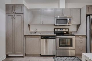 Photo 4: 504 30 Brentwood Common NW in Calgary: Brentwood Apartment for sale : MLS®# A1047644