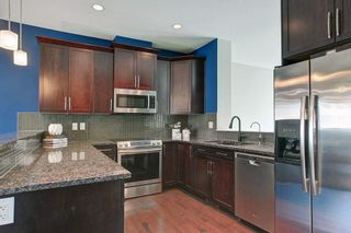 Photo 16: 1707 WENTWORTH Villa SW in Calgary: West Springs Row/Townhouse for sale : MLS®# C4253593