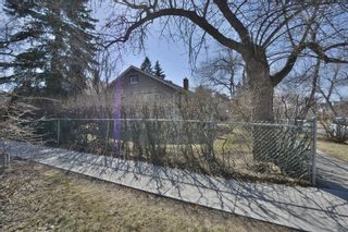 Main Photo: 1701 7 Avenue NW in Calgary: Hillhurst Detached for sale : MLS®# A1095097