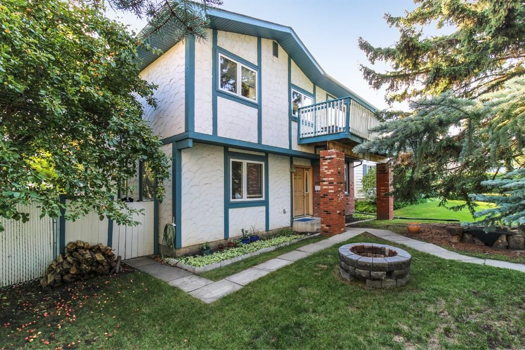 Main Photo: 143 Silver Brook Road NW in Calgary: Silver Springs Detached for sale : MLS®# A1141284