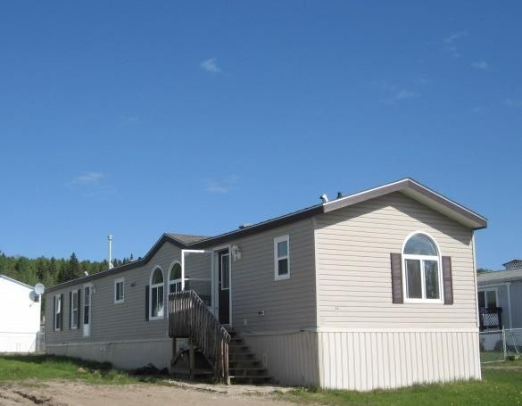 "Main Photo: 71 5701 AIRPORT Drive in Fort Nelson: Fort Nelson -Town Manufactured Home for sale in ""SOUTHRIDGE MOBILE HOME PARK"" (Fort Nelson (Zone 64))  : MLS®# N202027"
