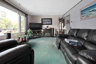 Photo 7: 10410 LAUDER Avenue in Edmonton: Zone 01 Attached Home for sale : MLS®# E4256925