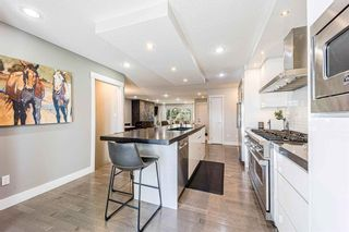 Photo 9: 9 Manor Road SW in Calgary: Meadowlark Park Detached for sale : MLS®# A1116064