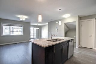 Photo 7: 555 Redstone View NE in Calgary: Redstone Row/Townhouse for sale : MLS®# A1149779