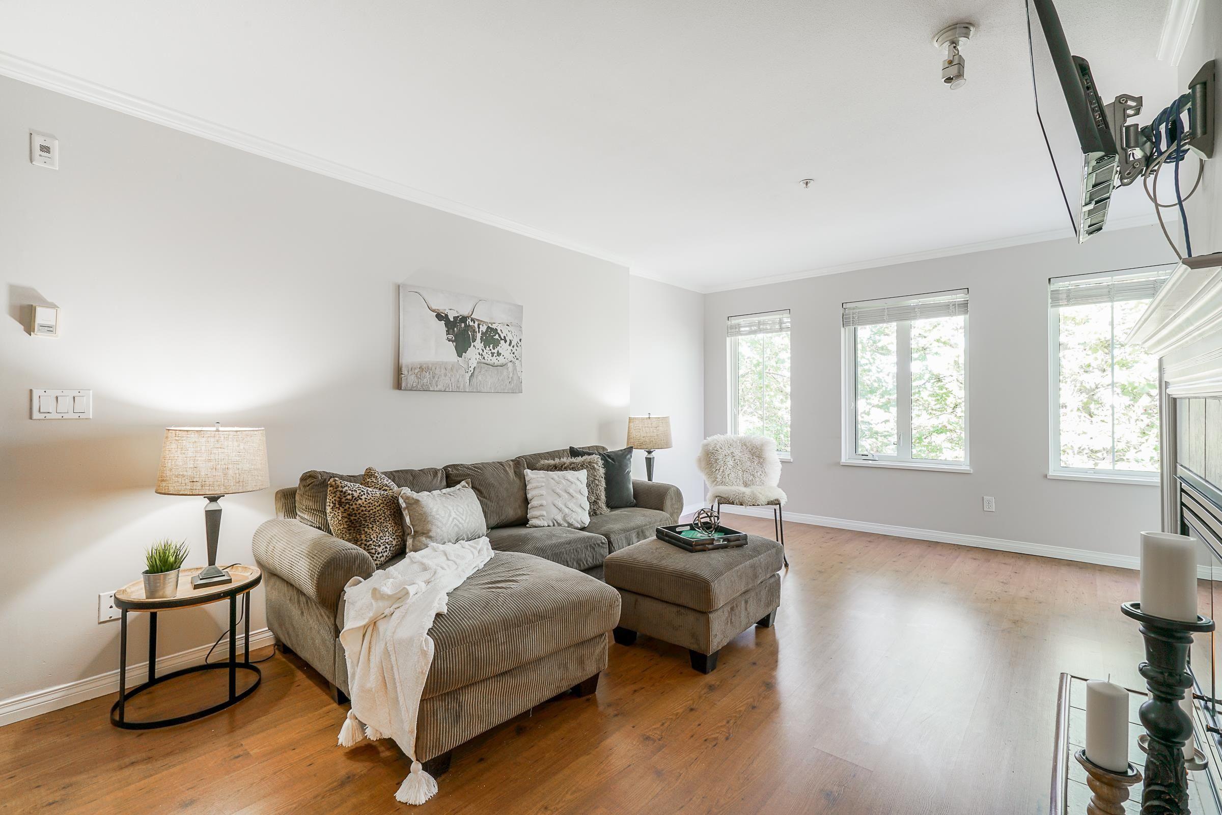 "Main Photo: 305 12125 75A Avenue in Surrey: West Newton Condo for sale in ""Strawberry Hills Estates"" : MLS®# R2618387"