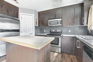 Photo 6: 49 Aspen Hills Drive in Calgary: Aspen Woods Row/Townhouse for sale : MLS®# A1108255