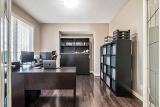 Photo 5: 157 Springbluff Boulevard SW in Calgary: Springbank Hill Detached for sale : MLS®# A1129724