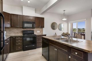 Photo 9: 407 620 Luxstone Landing SW: Airdrie Row/Townhouse for sale : MLS®# A1121530