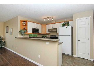 Photo 4: 103 15320 BANNISTER Road SE in CALGARY: Midnapore Condo for sale (Calgary)  : MLS®# C3587093