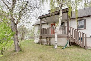 Photo 2: 401 55 Avenue SW in Calgary: Windsor Park Detached for sale : MLS®# A1114721