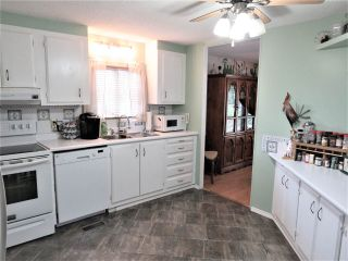 """Photo 11: 61 5742 UNSWORTH Road in Sardis: Vedder S Watson-Promontory Manufactured Home for sale in """"Cedar Grove"""" : MLS®# R2405974"""