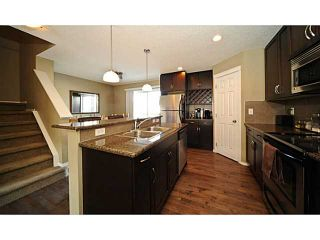 Photo 2: 14 COUNTRY VILLAGE Gate NE in CALGARY: Country Hills Village Townhouse for sale (Calgary)  : MLS®# C3578013