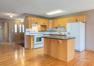 Photo 4: 6 8 Riverview Circle: Cochrane Semi Detached for sale : MLS®# A1110223