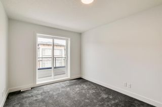 Photo 19: 19609 45 Street SE in Calgary: Seton Row/Townhouse for sale : MLS®# A1142177
