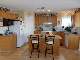 Photo 4: 159 FAIRWAYS Close NW: Airdrie Residential Detached Single Family for sale : MLS®# C3602387