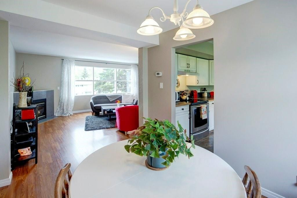 Photo 11: Photos: 615 Merrill Drive NE in Calgary: Winston Heights/Mountview Row/Townhouse for sale : MLS®# C4301720