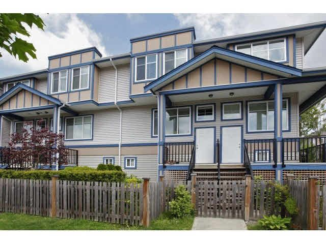 "Main Photo: 60 13899 LAUREL Drive in Surrey: Whalley Townhouse for sale in ""EMERALD GREEN"" (North Surrey)  : MLS®# F1441178"