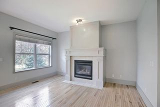 Photo 5: 63 Wentworth Common SW in Calgary: West Springs Row/Townhouse for sale : MLS®# A1124475