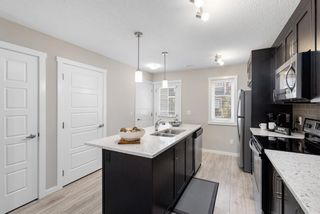 Photo 9: 1011 2400 Ravenswood View SE: Airdrie Row/Townhouse for sale : MLS®# A1121287