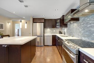 """Photo 22: 301 1470 PENNYFARTHING Drive in Vancouver: False Creek Condo for sale in """"Harbour Cove"""" (Vancouver West)  : MLS®# R2563951"""