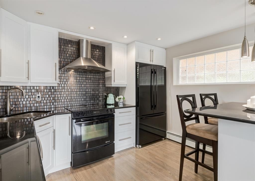 Main Photo: 5 1611 26 Avenue SW in Calgary: South Calgary Apartment for sale : MLS®# A1118518