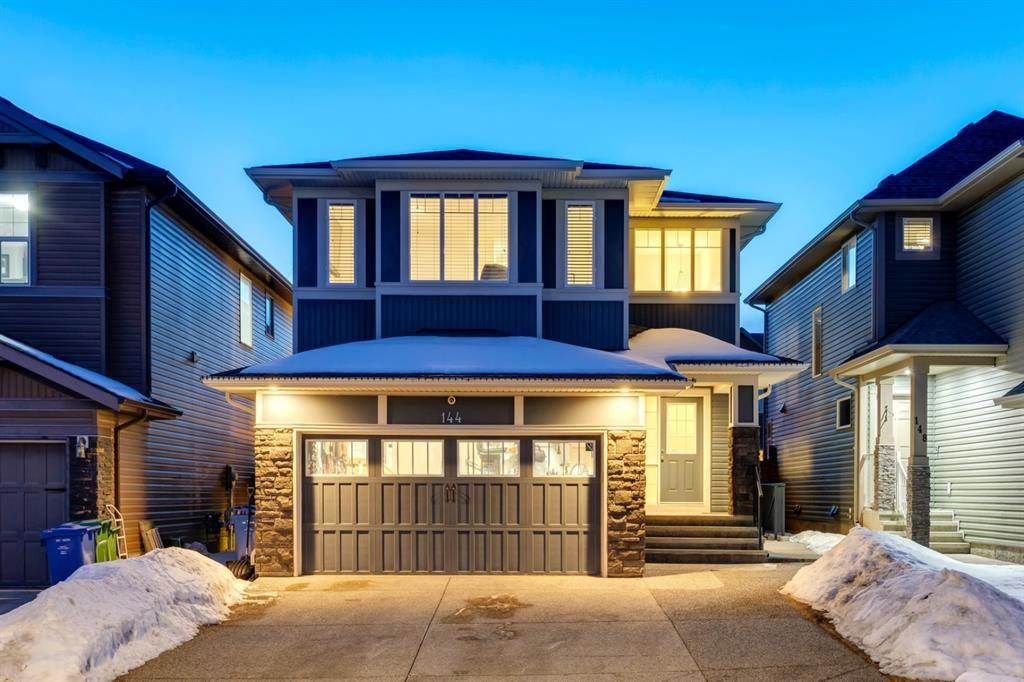 Main Photo: 144 Cougar Ridge Manor SW in Calgary: Cougar Ridge Detached for sale : MLS®# A1098625